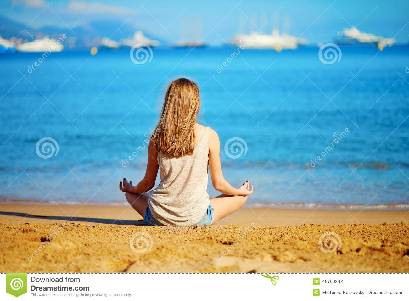 Young girl enjoying her vacation by the sea stock photo for Cabin by the sea