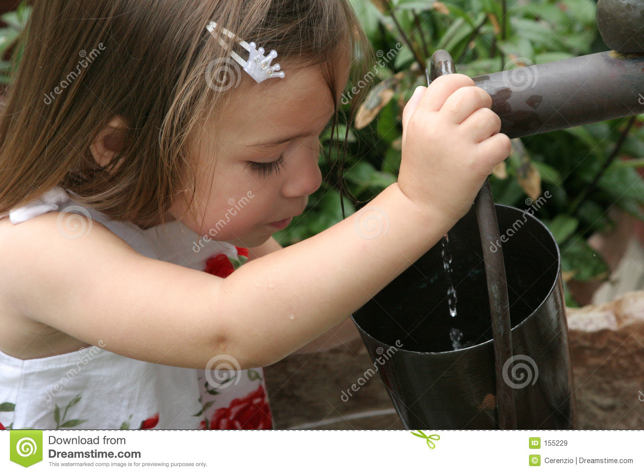 Young girl filling bucket