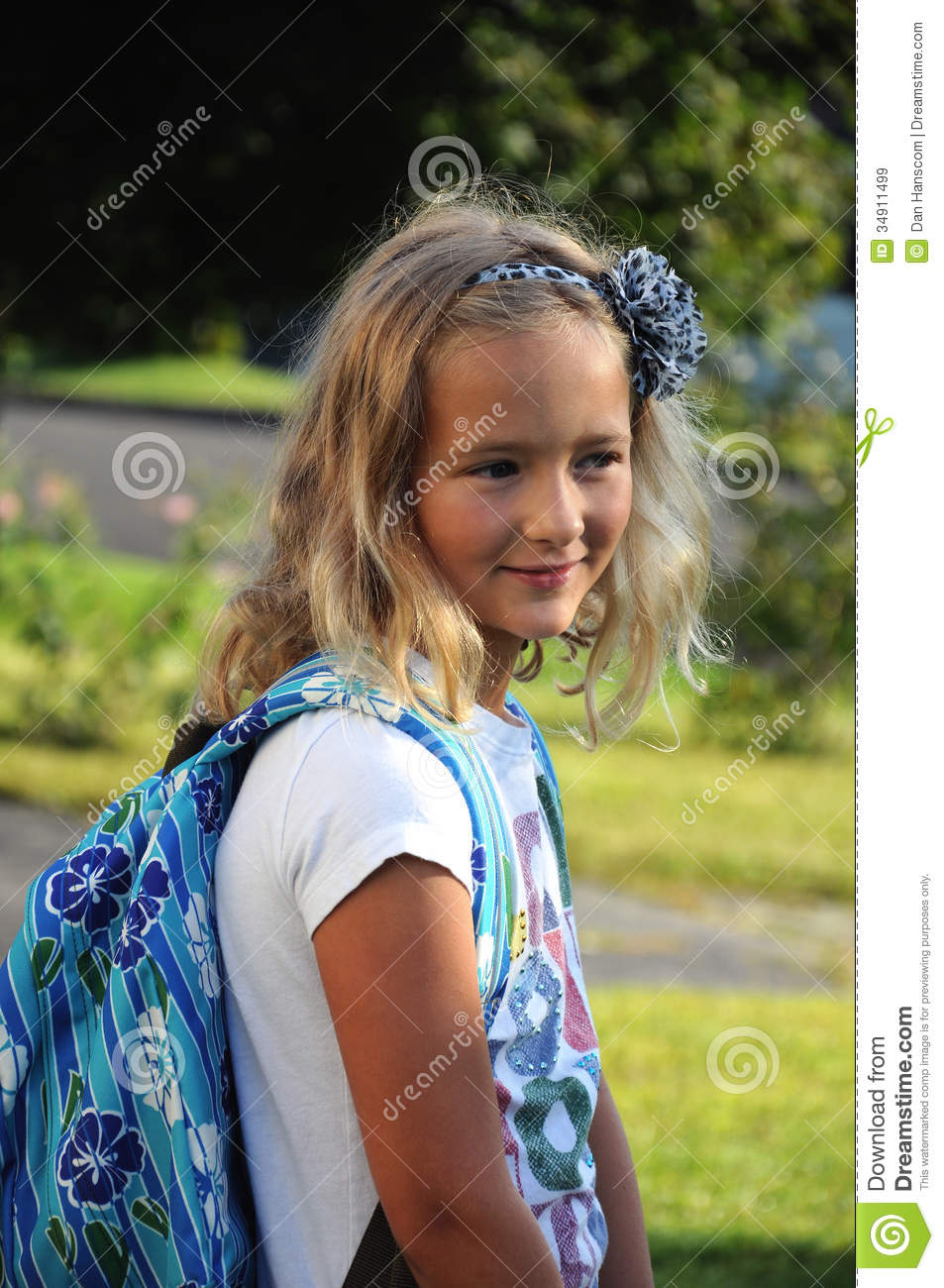 Young girl on the first day of school