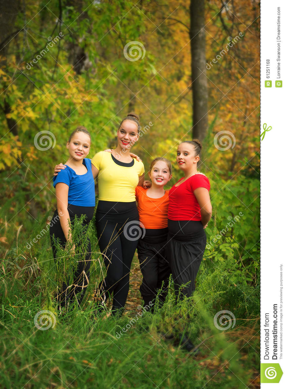 Young Girl Friends in the Forest in Autumn
