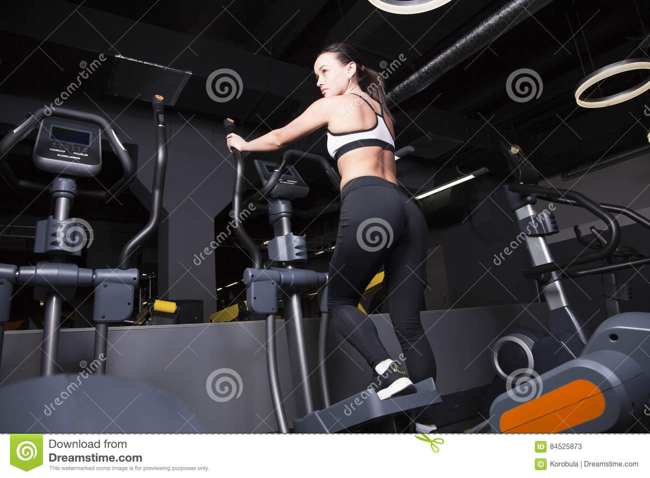 A young girl goes in for sports in the gym .
