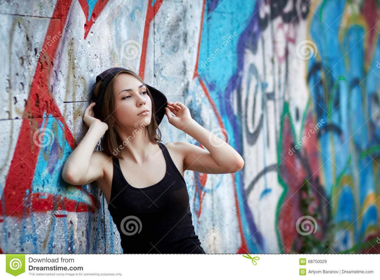 Young girl on graffiti background