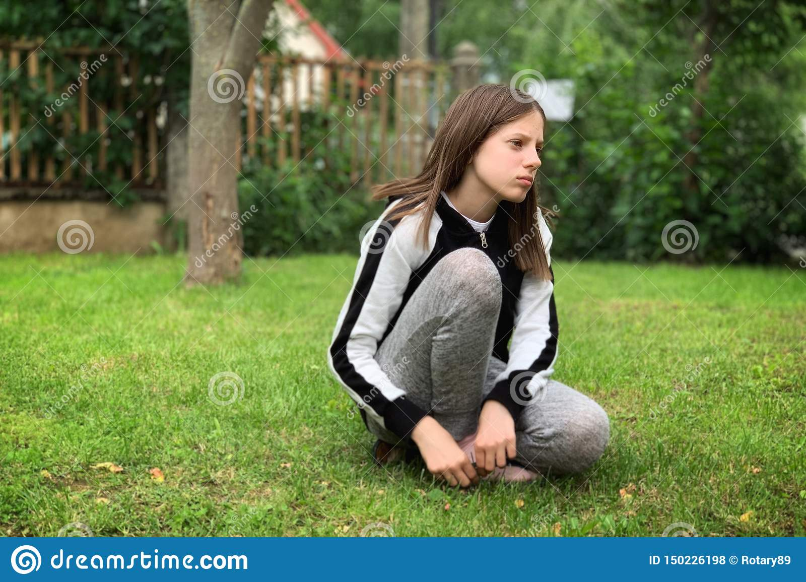 Young girl on the grass.
