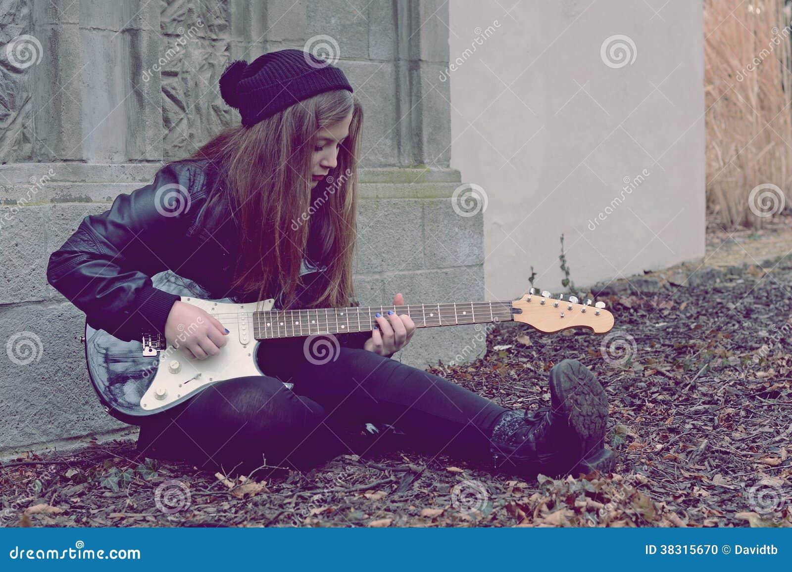 Sad girl with electric guitar