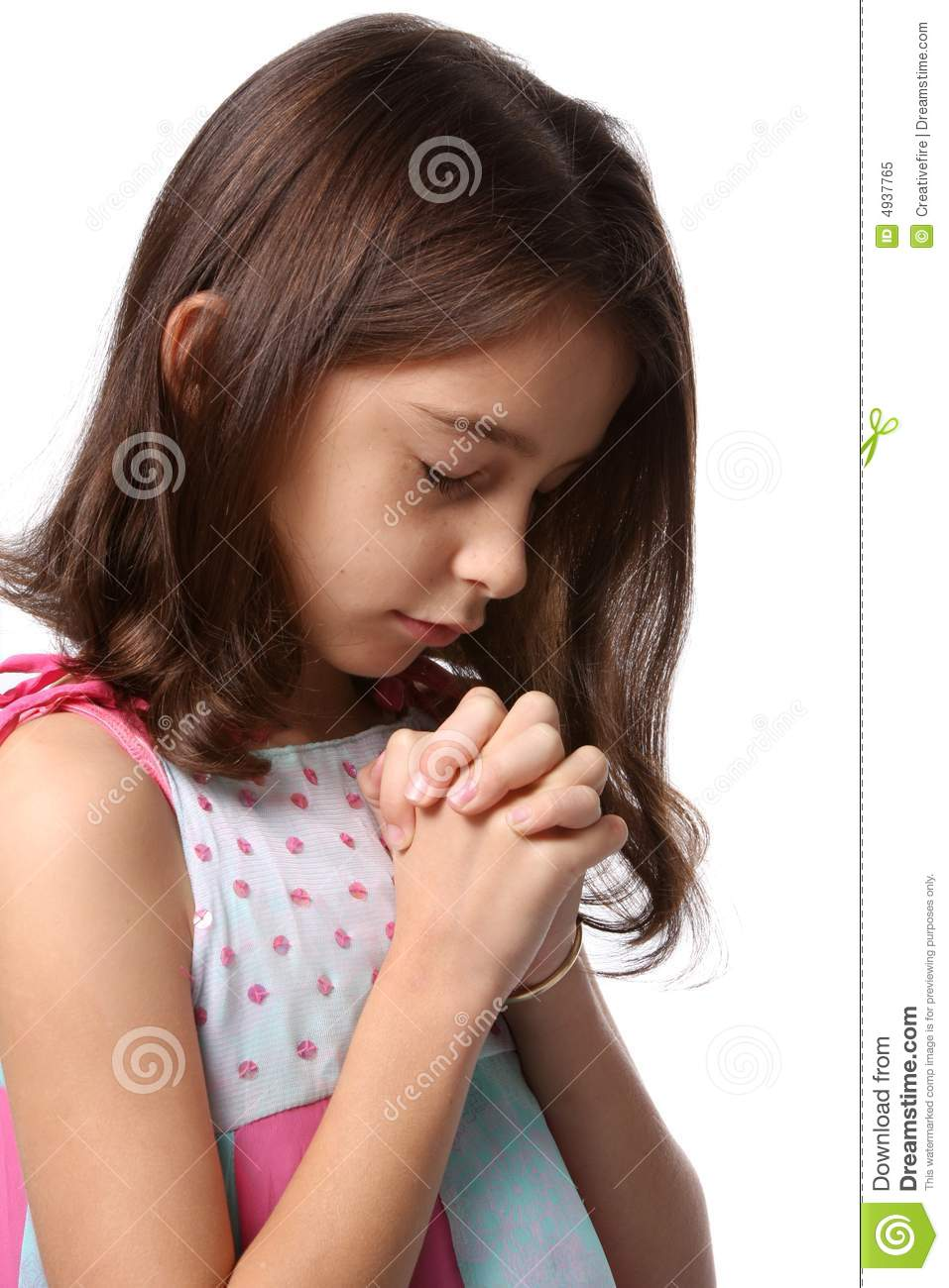young girl   head bowed in prayer royalty free stock photo