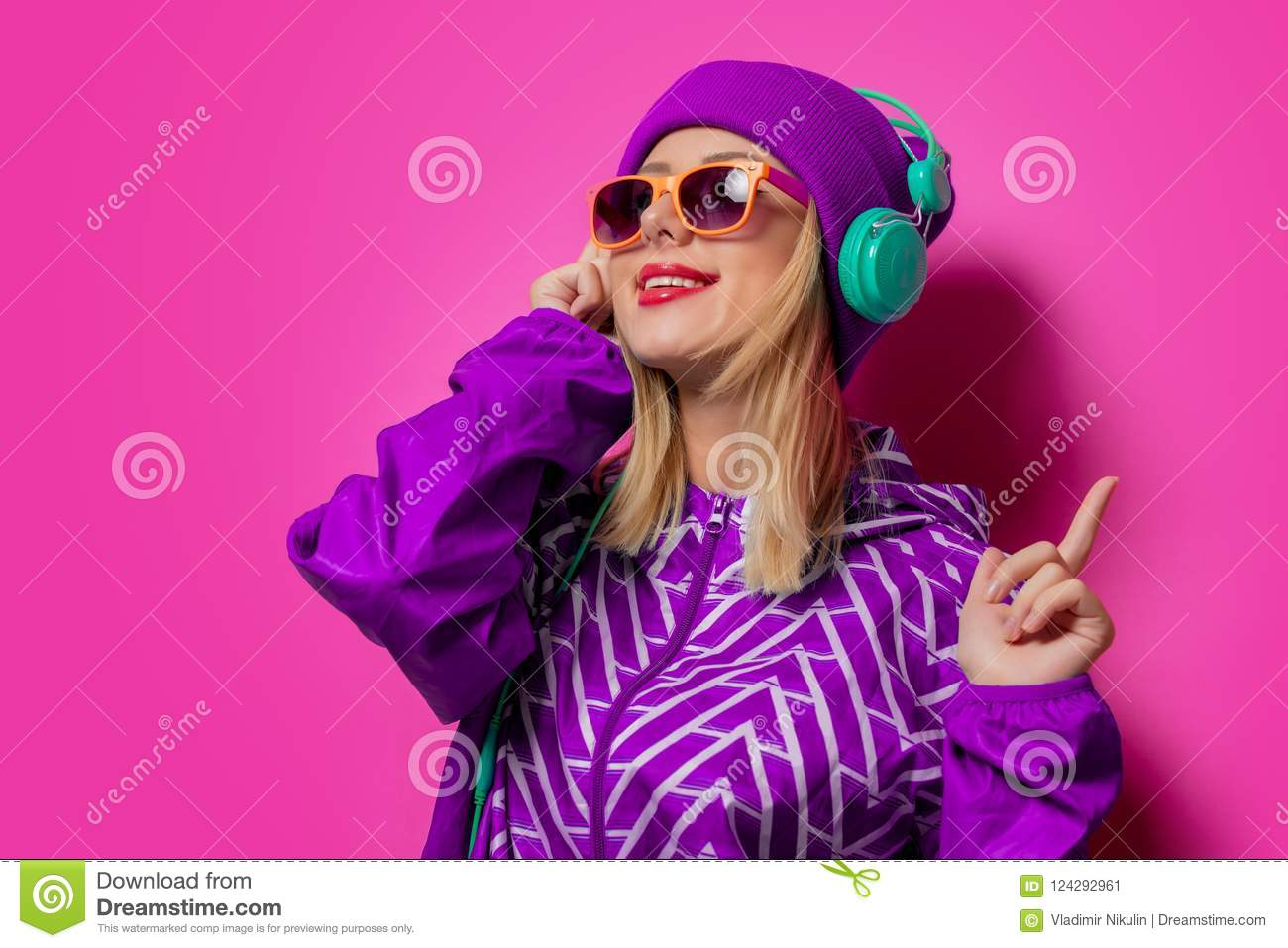 Young girl with headphones in sports jacket