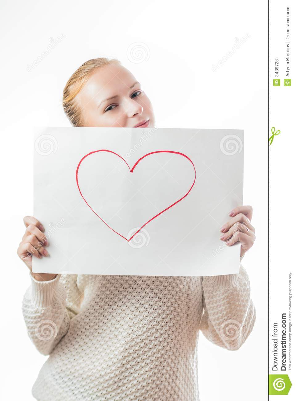Young girl with the heart on the sheet of paper