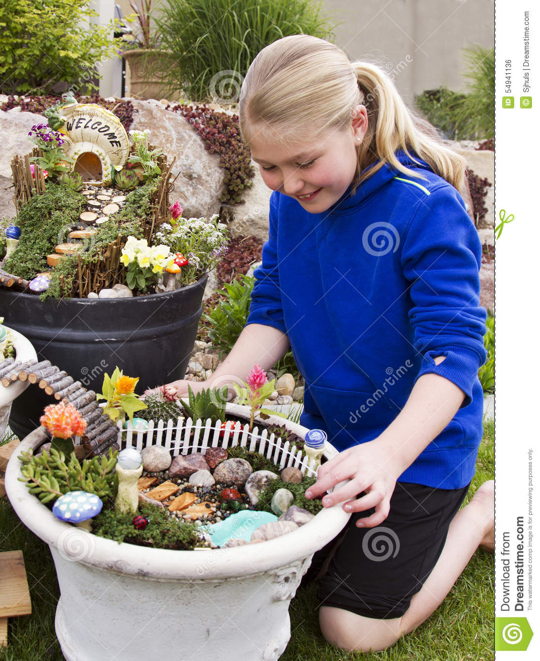 Young Girl Helping To Make Fairy Garden In A Flower Pot Stock Photo Image 54941136