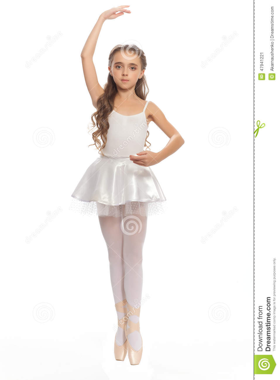 young girl in her dance clothes reaching down to touch her