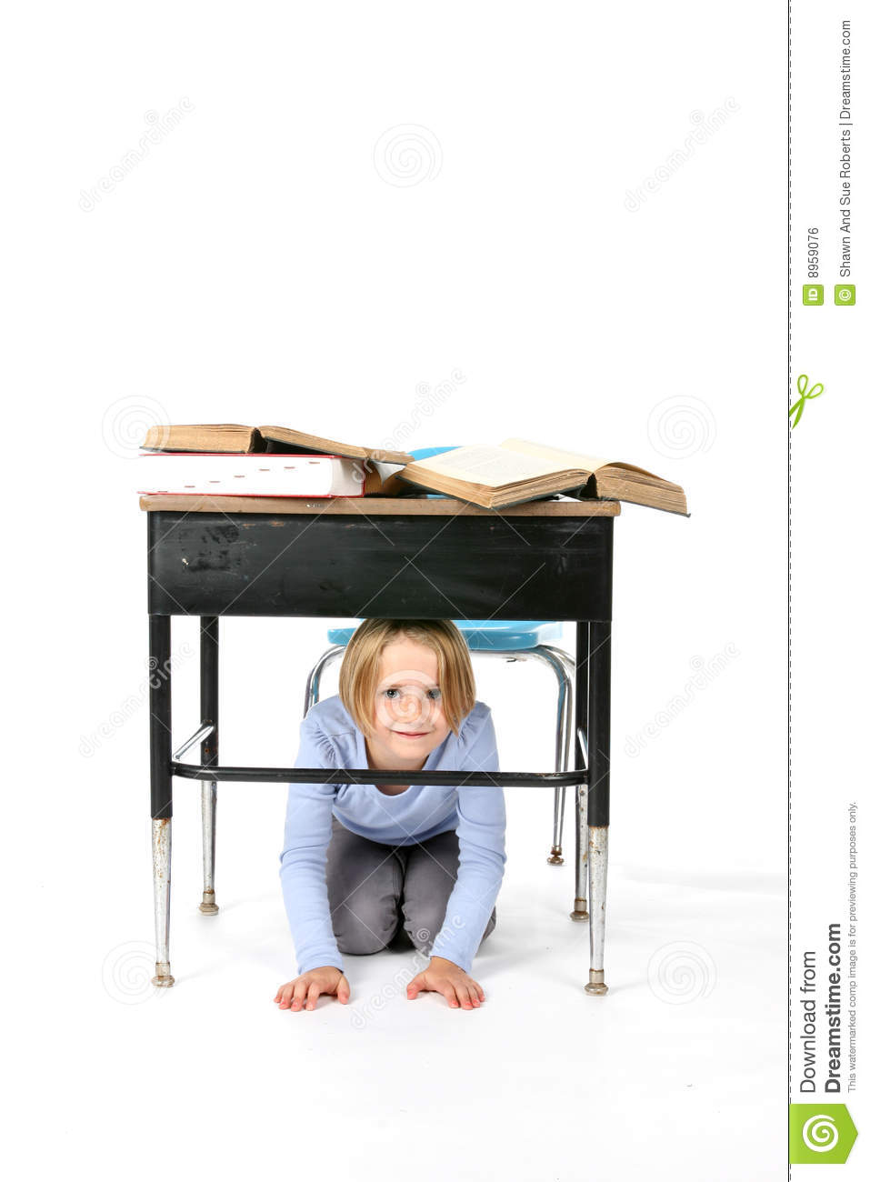 Young Girl Hiding Under A School Desk Royalty Free Stock ...