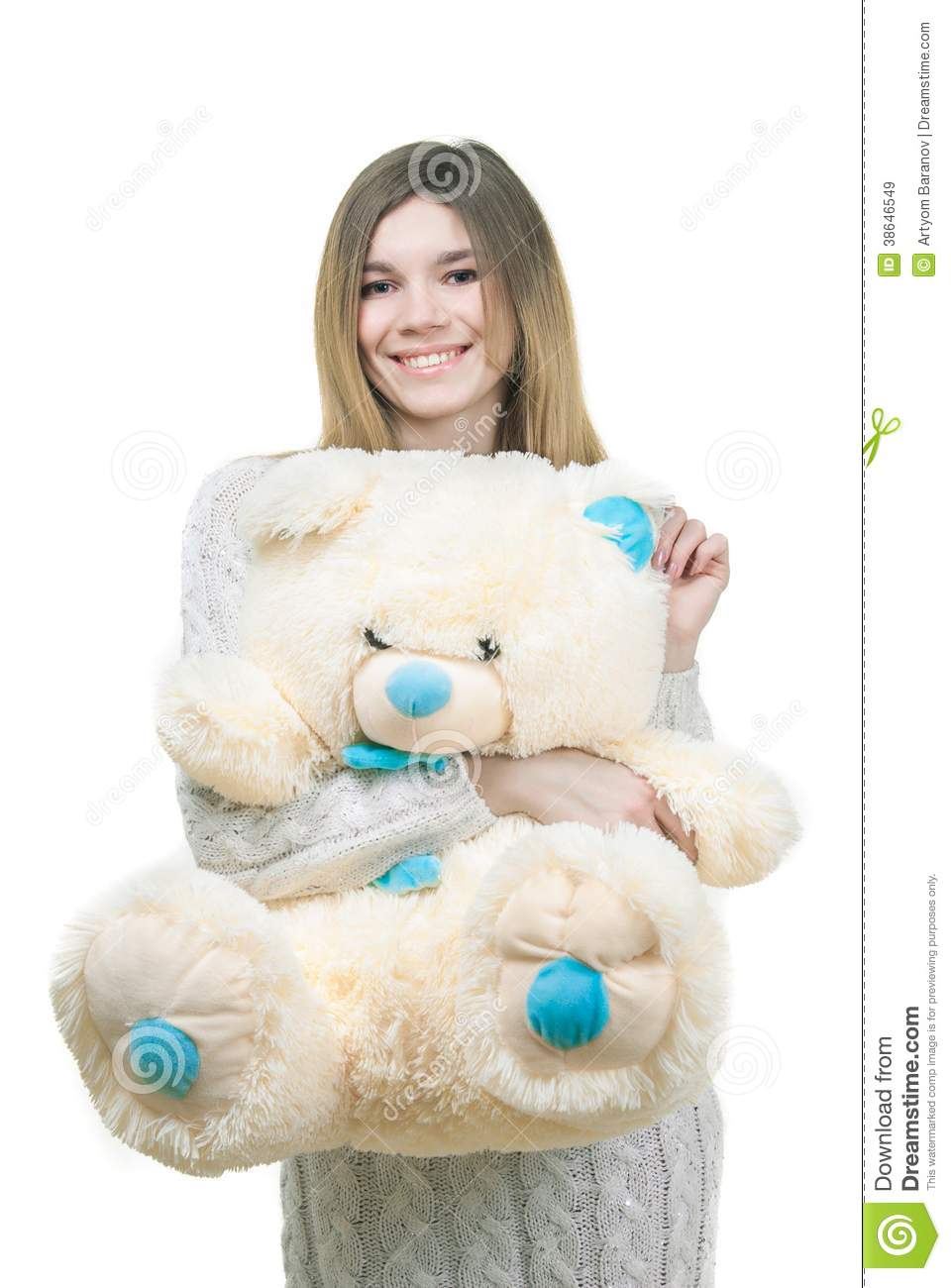 Young girl holding big teddy bear