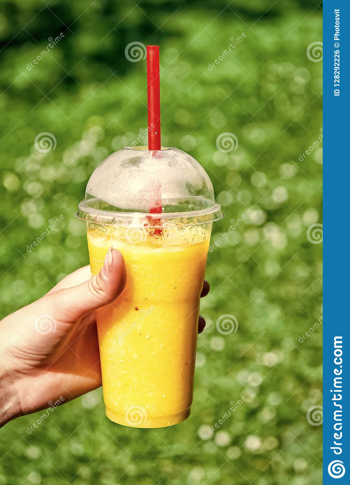 Young girl holding good healthy breakfast fruit smoothie drink