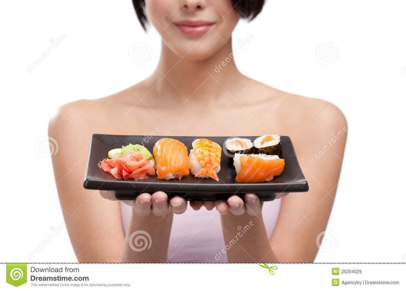Young girl holding plate of sushi