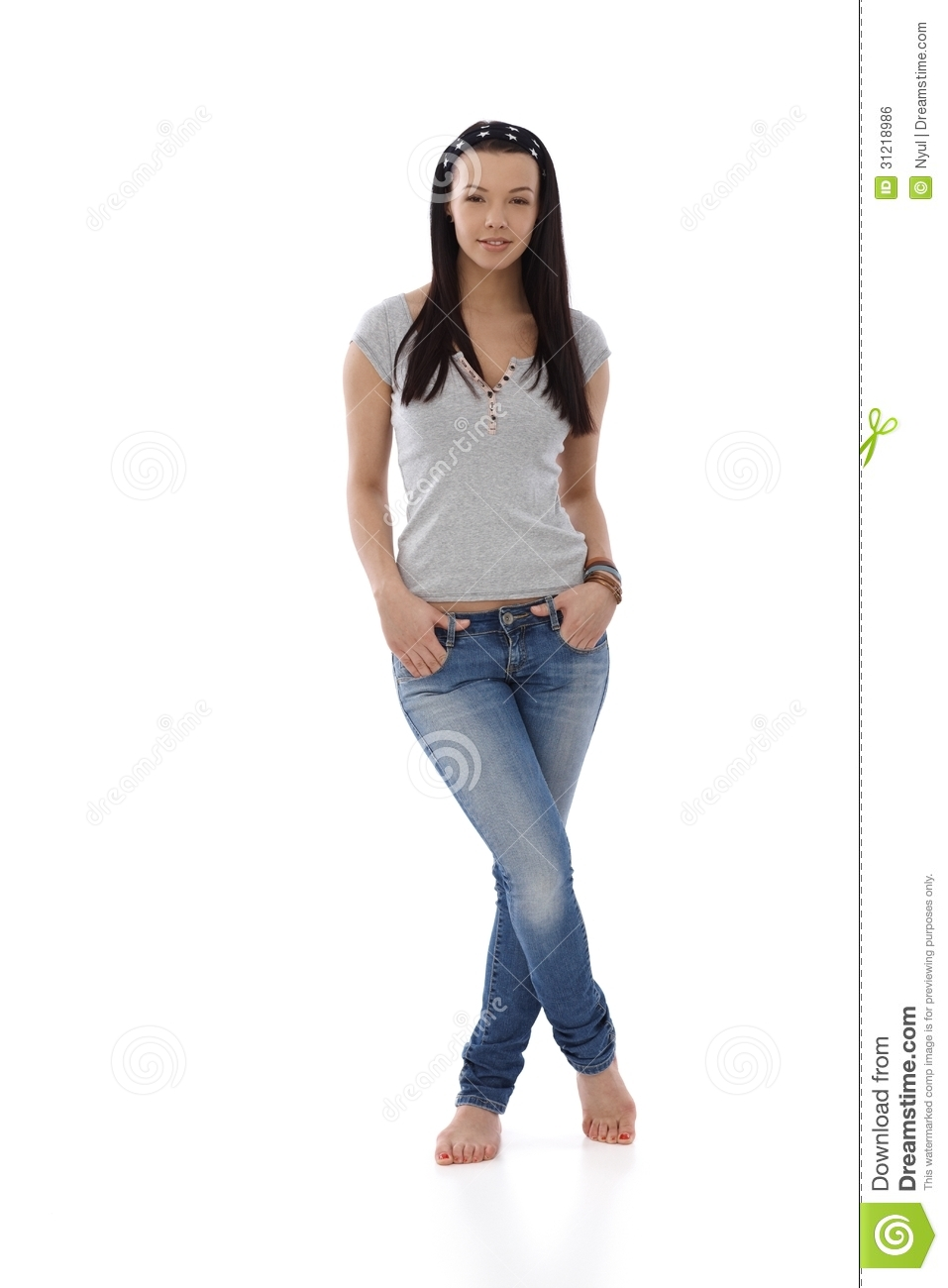 Young Girl In Jeans And T-shirt Standing Barefoot Stock Photo - Image of cutout female 31218986