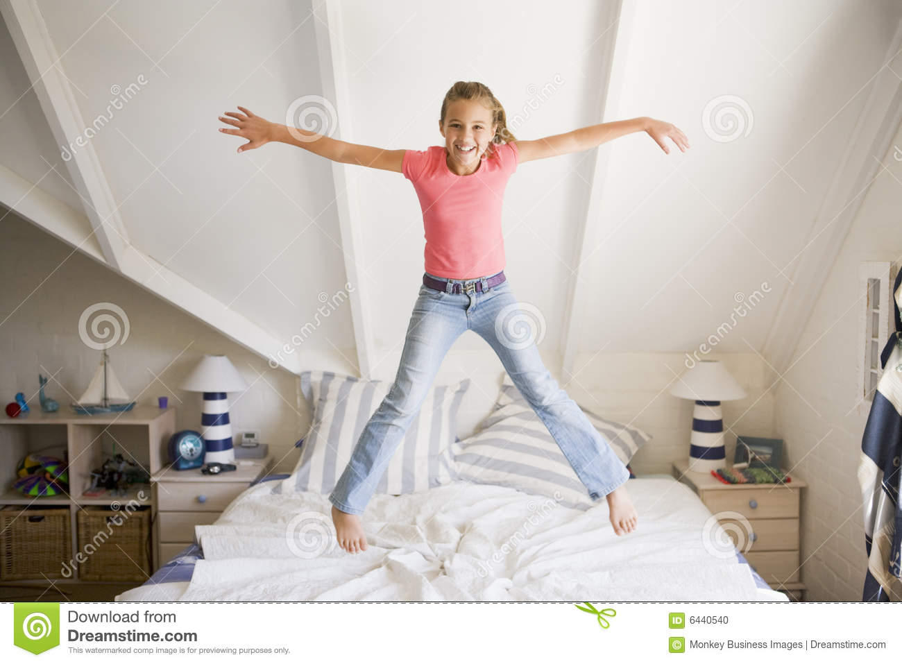 Young Girl Jumping On Her Bed Stock Photo Image 6440540
