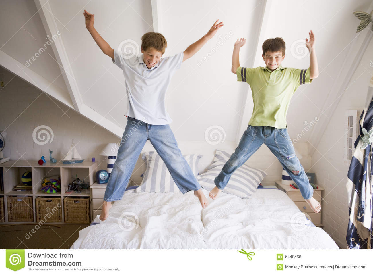 Young Girl Jumping On Her Bed Stock Photo Image Of