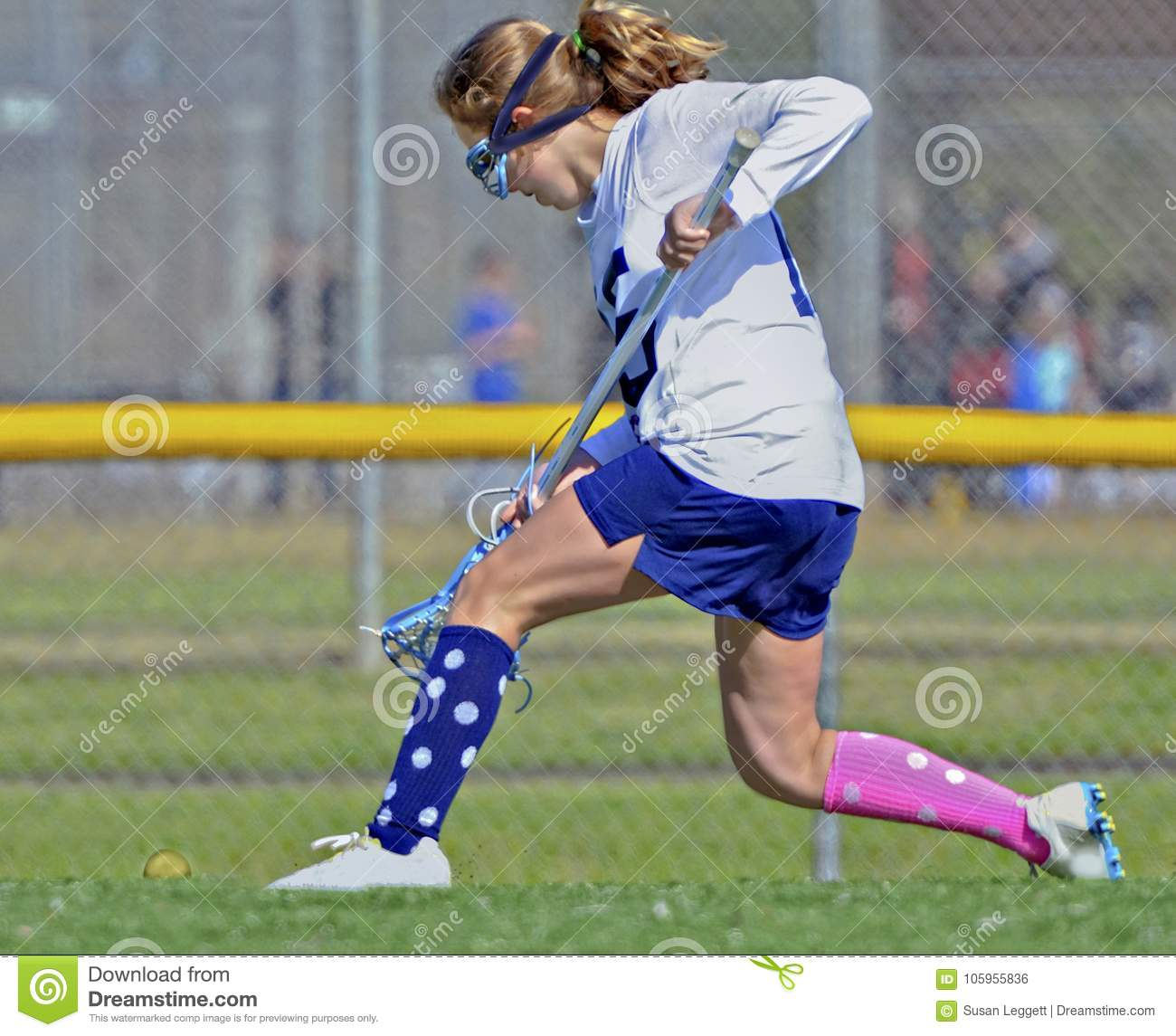 Young Girl Lacrosse Player Running for the Ball