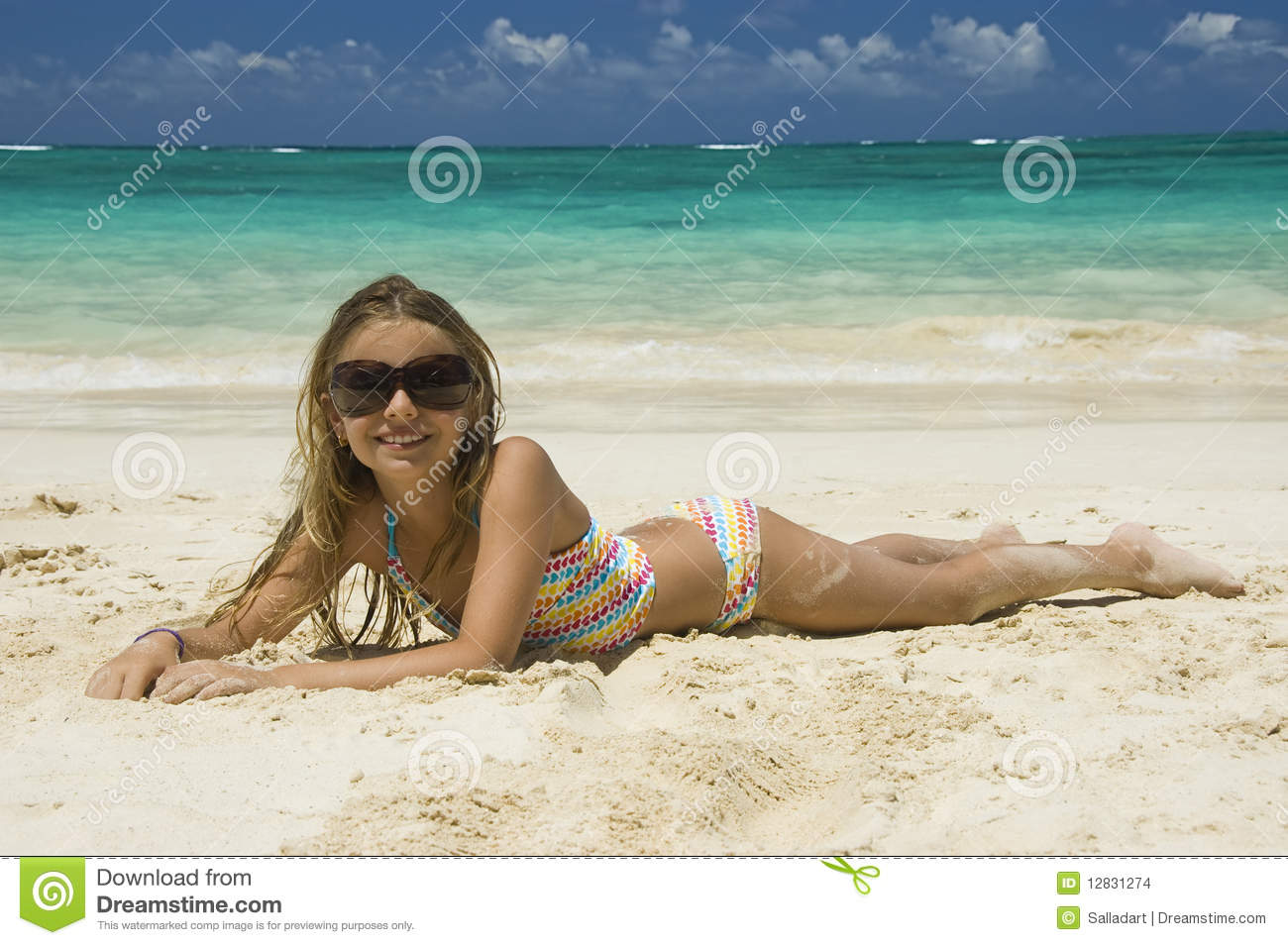 Young and tanned beach girls something is