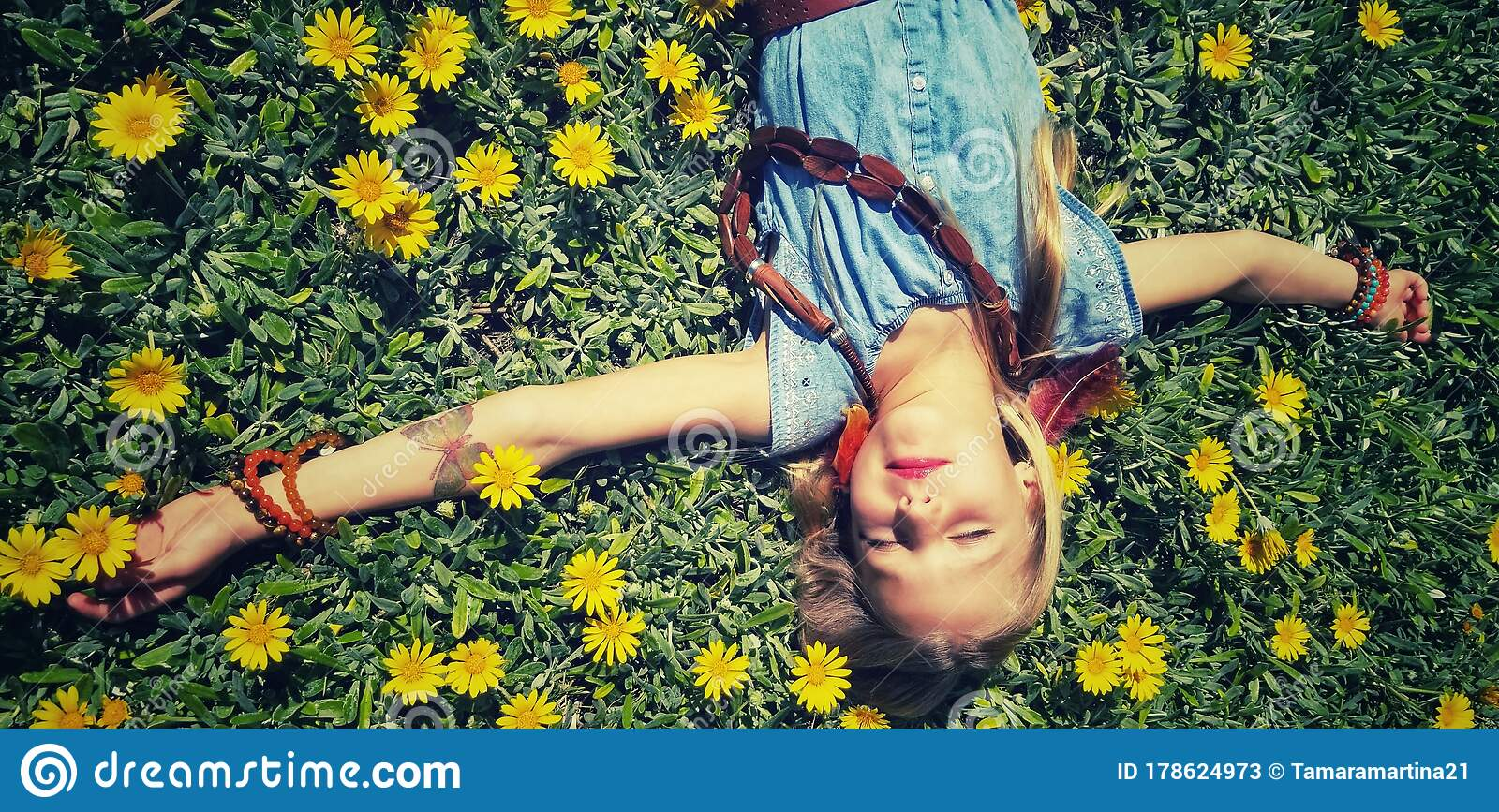 Young Girl Laying In Field Of Yellow Flowers Stock Image ...