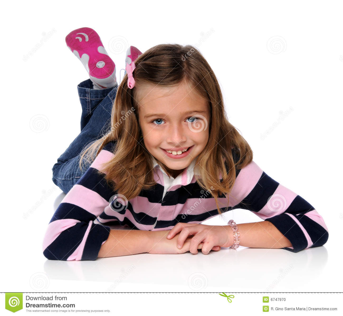 Young Girl Laying On The Floor Stock Photo