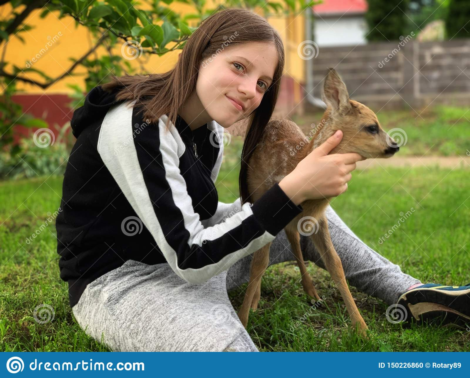 Young girl and a little deer