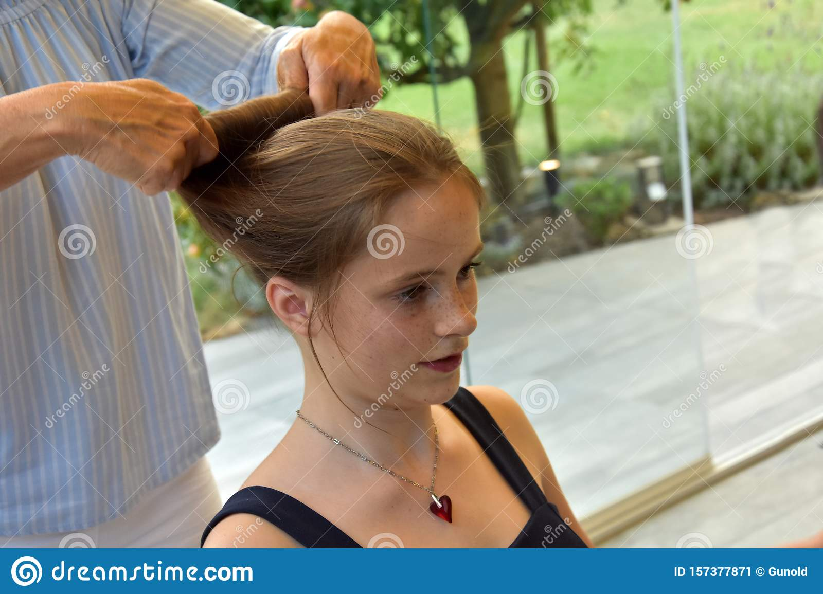 Teenage girl gets a new hairstyle