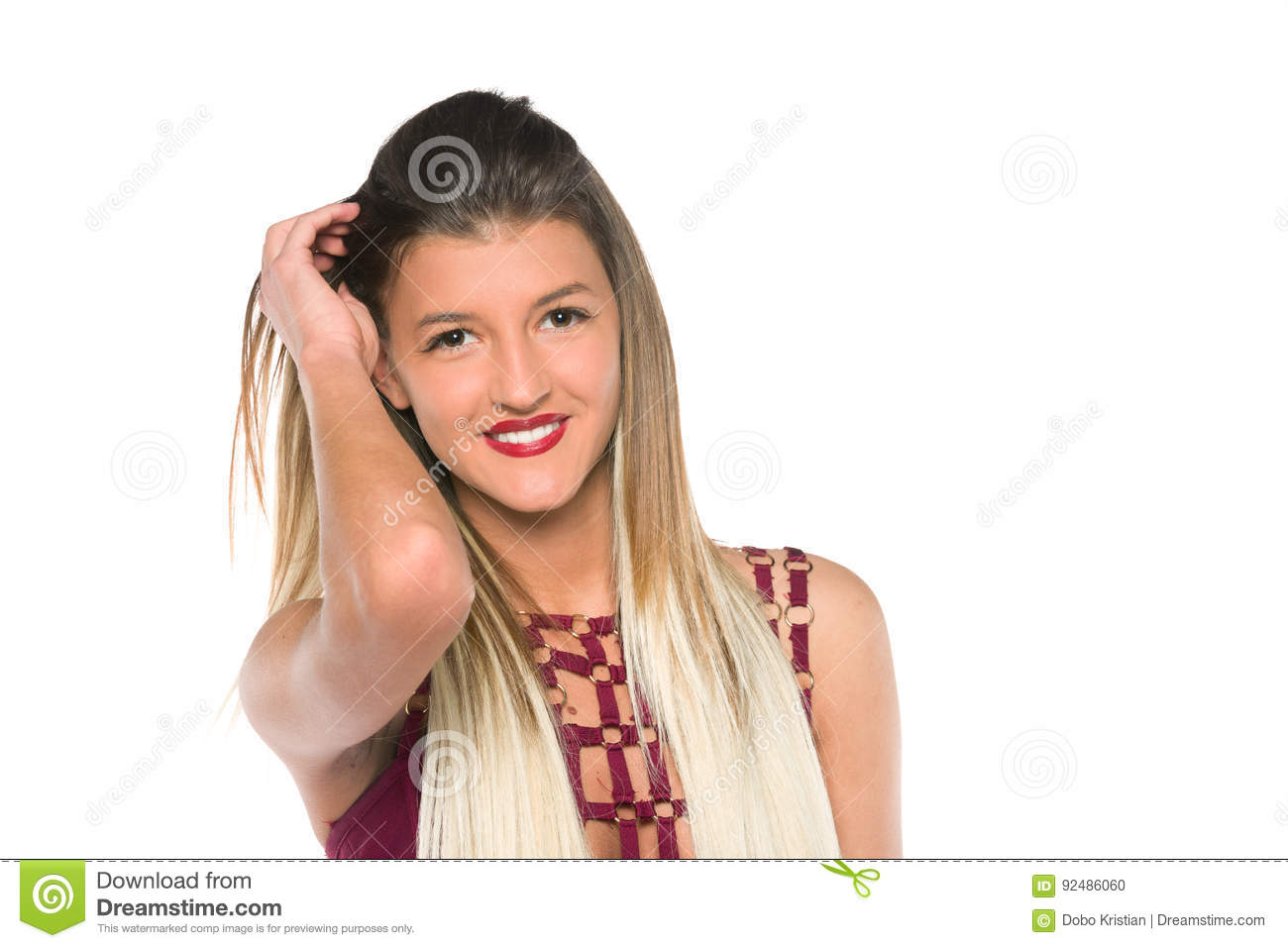 Young girl with long hair posing in studio