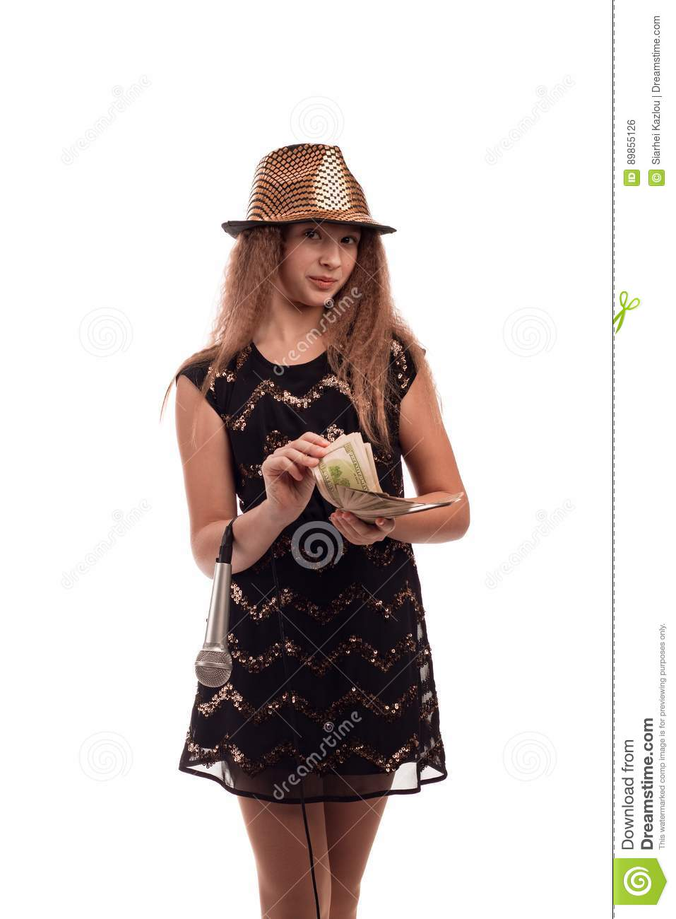 Young Girl With Long Hair Wearing A Black Dress And Gold Hat With A
