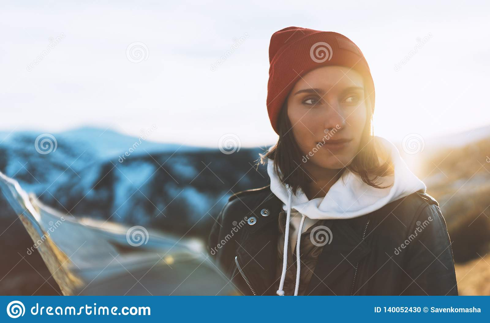 Young girl look and hold in hands map, people planning trip, hipster tourist on background sun flare nature, enjoy journey land