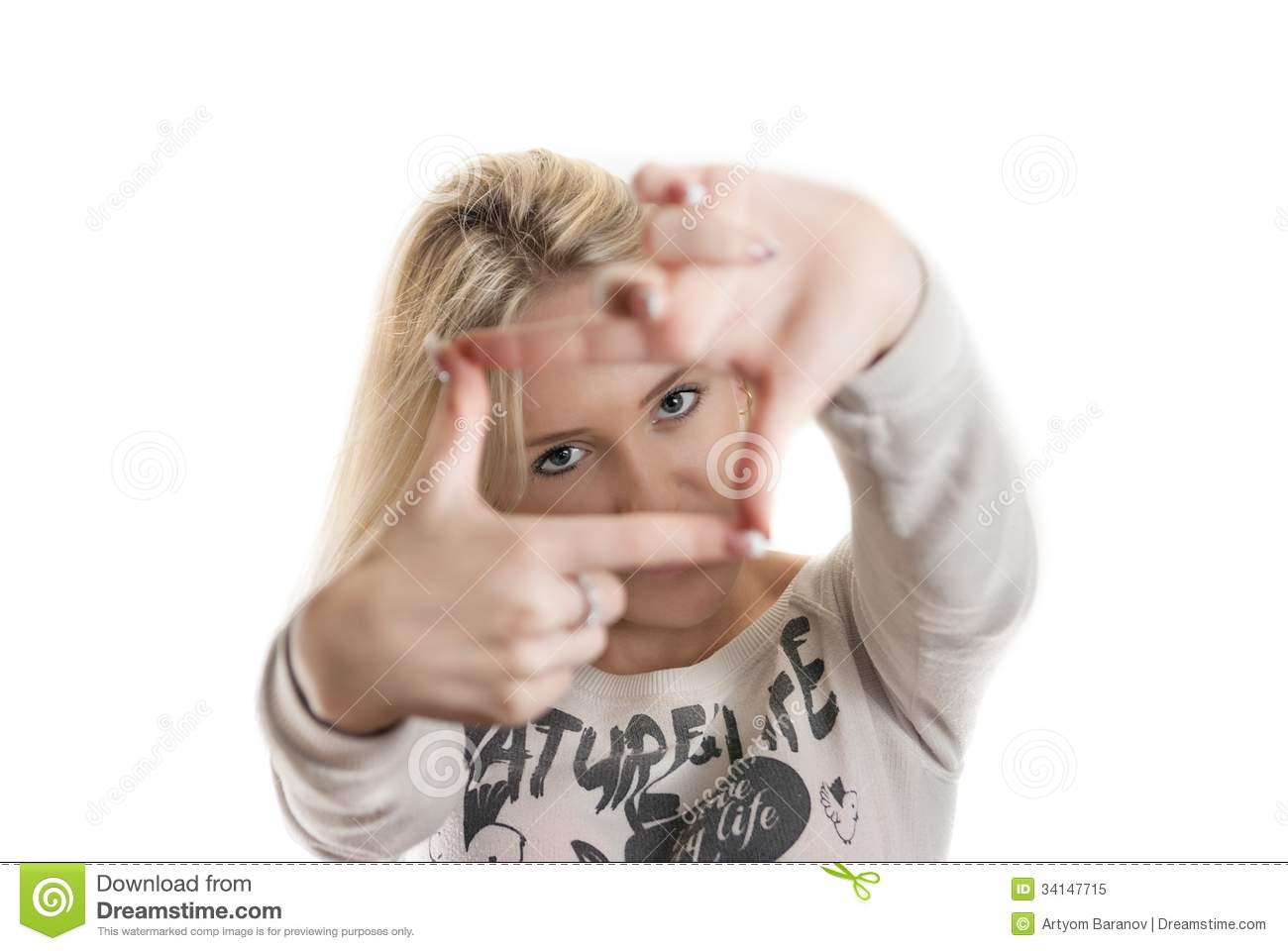 young girl looking through her hands stock image