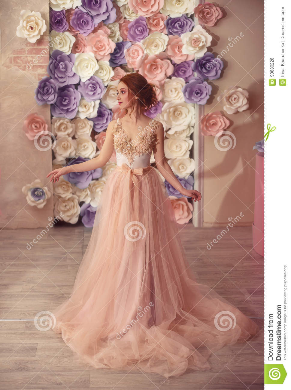 A young girl in a luxurious dress