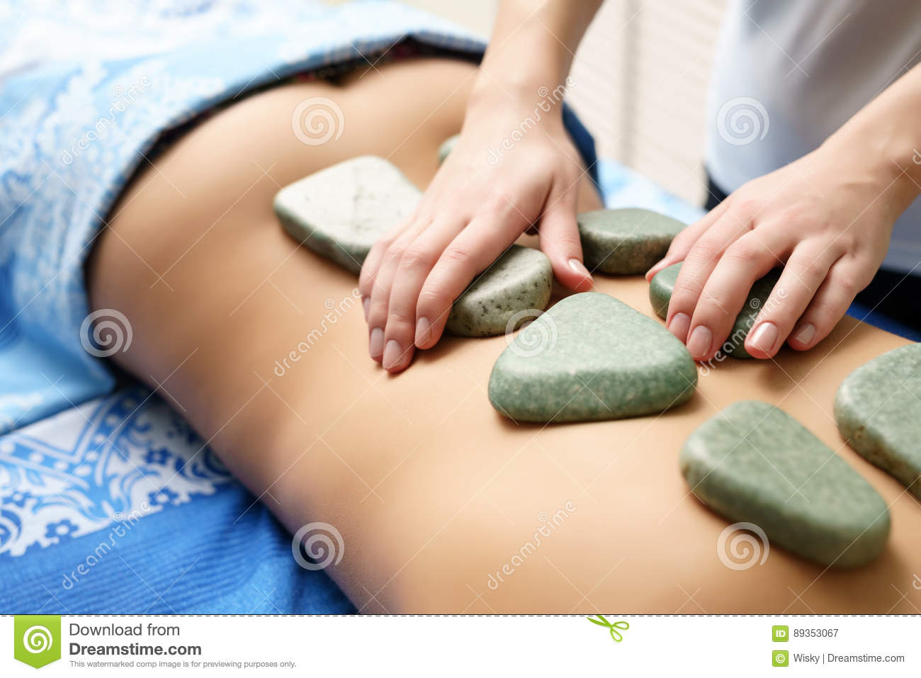 Girl laying on stomach getting a massage