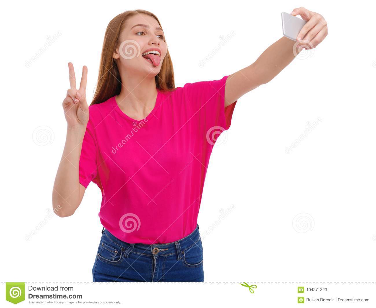 A Young Girl Makes Selfie And Sticking Out Her Tongue And Showing