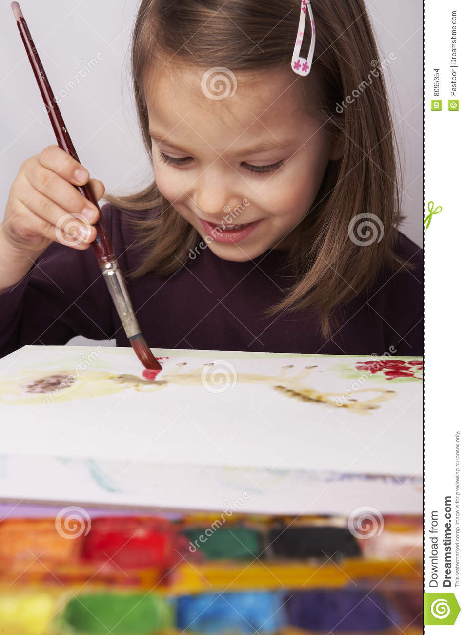 Young girl painting picture