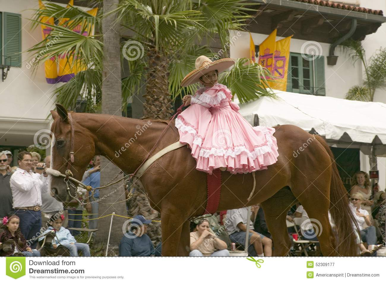 Young girl in pink dress rides horse in annual Old Spanish Days Fiesta held every August in Santa Barbara, California