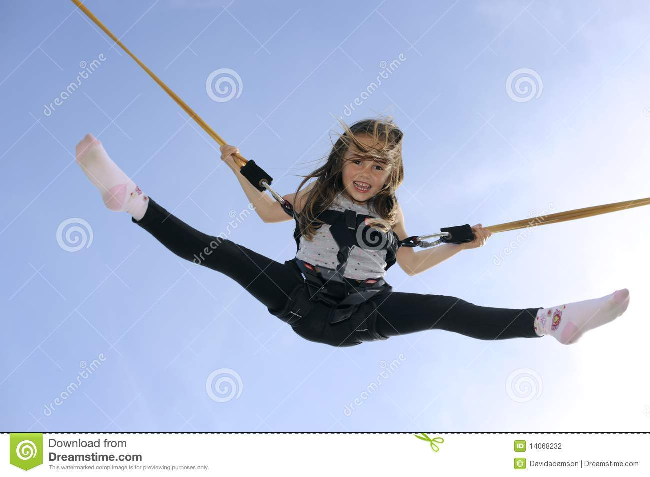 Girl Years Old Bouncing High In The Air Using A Bungee Trampoline