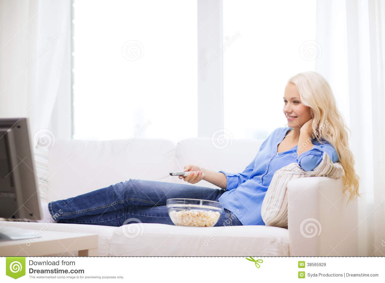 Young girl with popcorn watching movie at home royalty for People watching