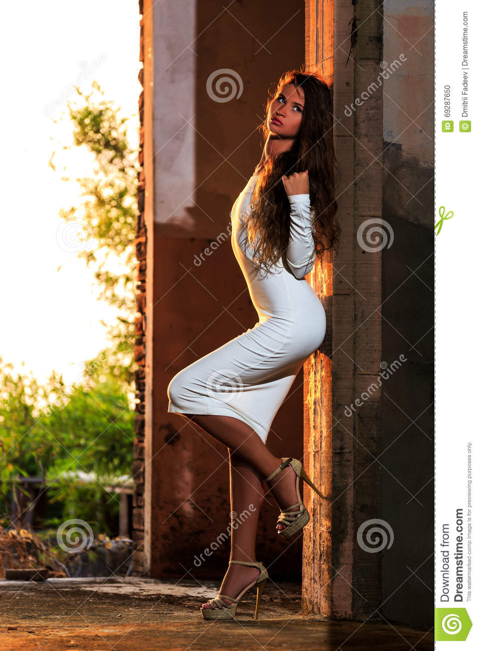 Young Girl Posing In An Abandoned Building Stock Photo