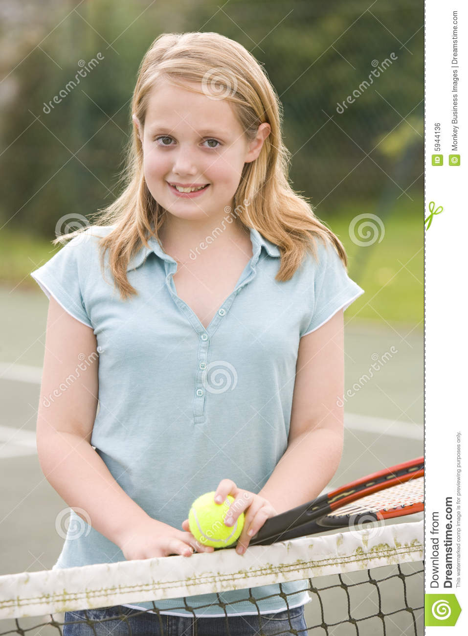 Young Girl With Racket On Tennis Court Smiling Royalty Free Stock ...