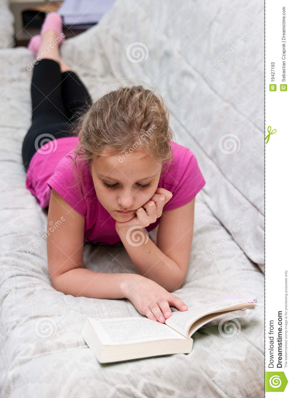 Young girl reading book stock image. Image of pretty