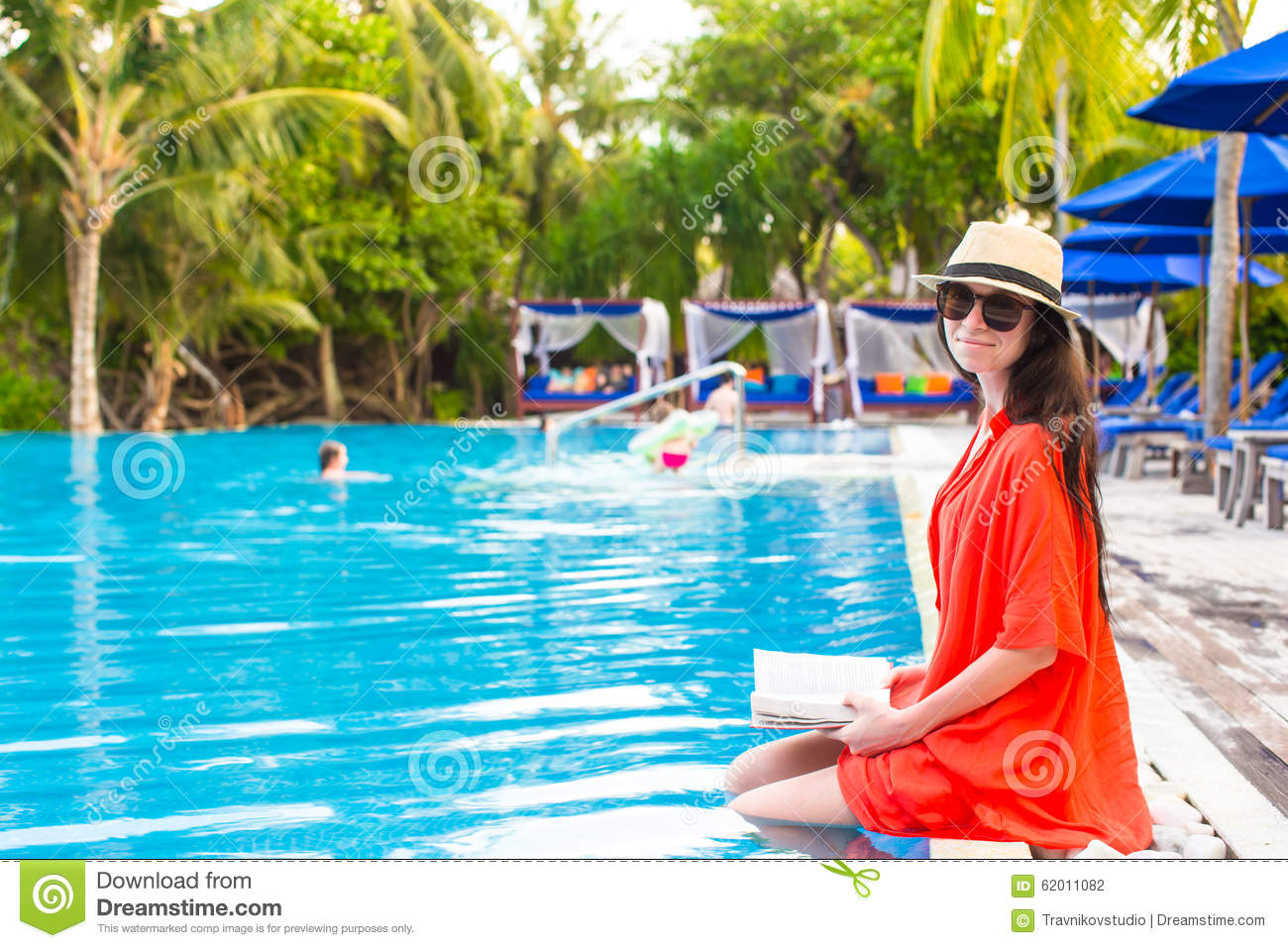 young girl reading book relaxing in swimming pool stock photo image 62011082