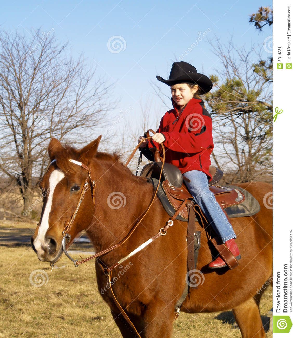 Young girl riding horse