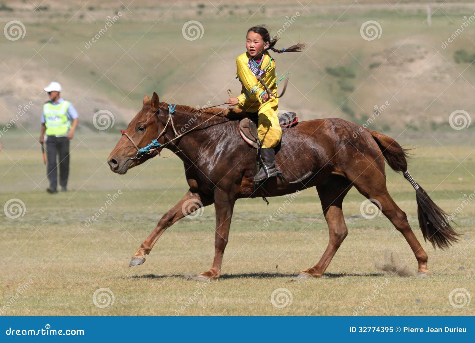 KHARKHORIN, MONGOLIA, JULY, 8 - Horse racing during Naadam midsummer ...