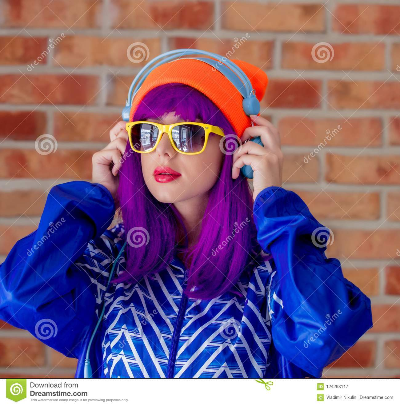Young girl in 90s sports jacket and hat