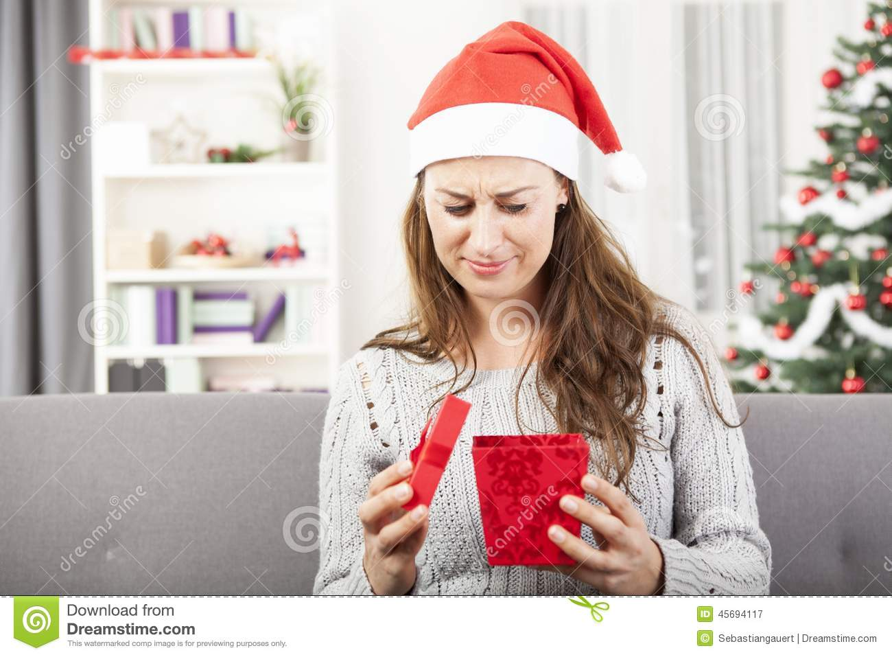 young girl is sad about christmas gift