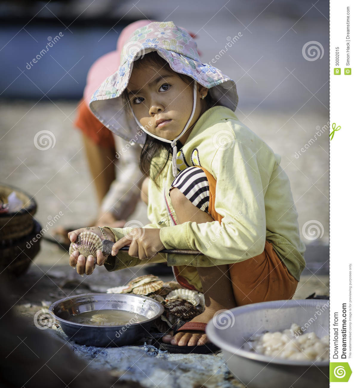 A Young Girl Shelling Scallops In Vietnam Editorial Image