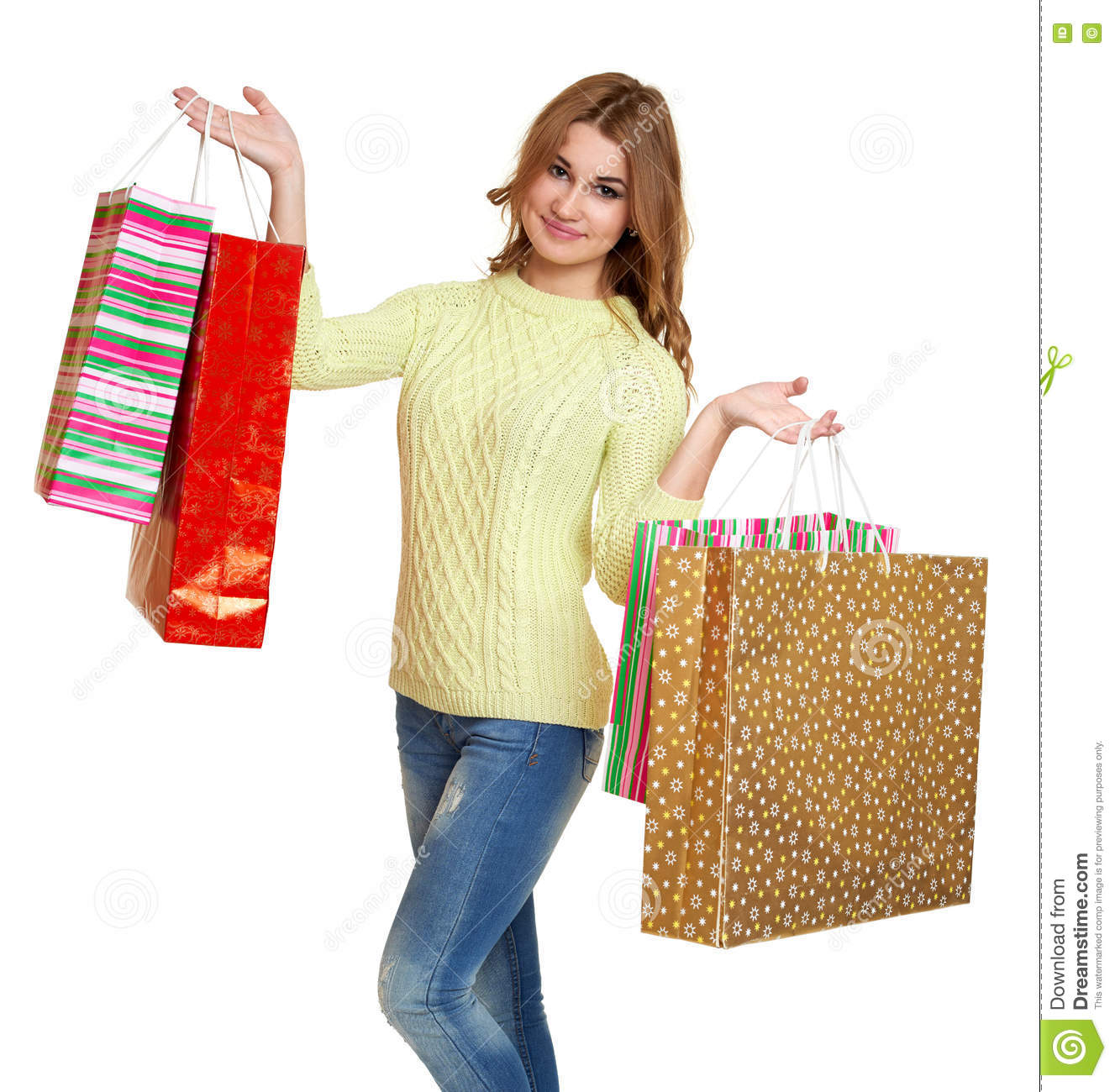 Woman posing with shopping bags isolated on white background full - Young Girl With Shopping Bag Casual Dressed Jeans And A Green Sweater Posing In Studio On