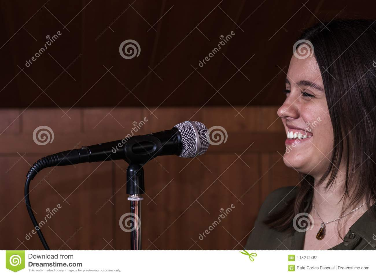 Girl singing with a microphone in a music studio