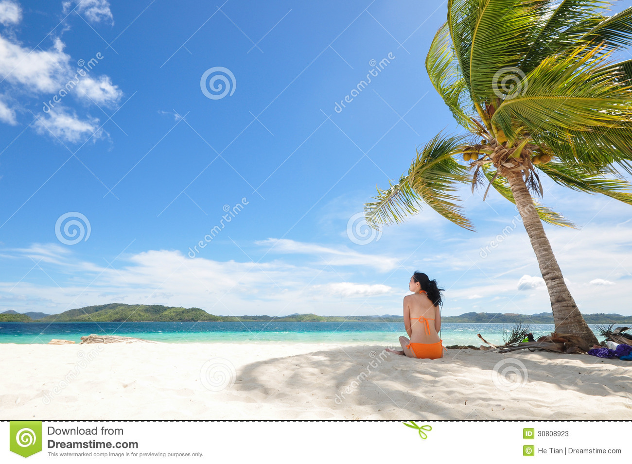 Young Girl Sitting On Beach Under Coconut Tree Stock Image