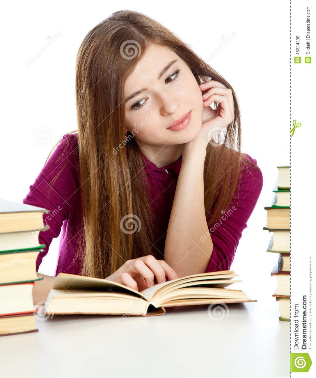 Young girl sitting at the desk and reading book royalty free stock photo image 15394335 - Desk girl image in ...